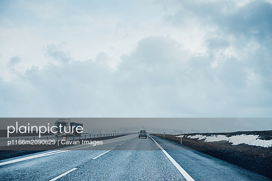 Icy Road in winter in Iceland - p1166m2090629 by Cavan Images