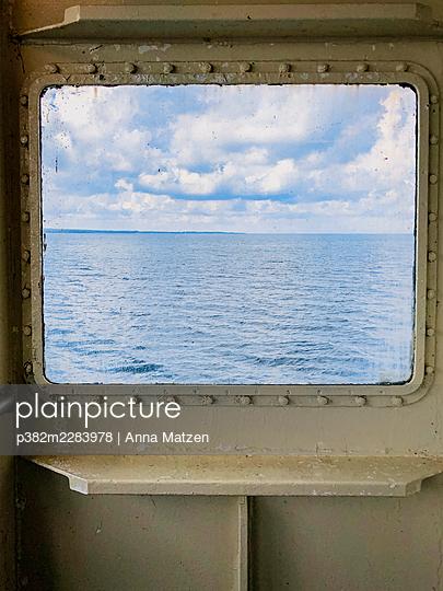 View through cabin window to the Baltic Sea - p382m2283978 by Anna Matzen