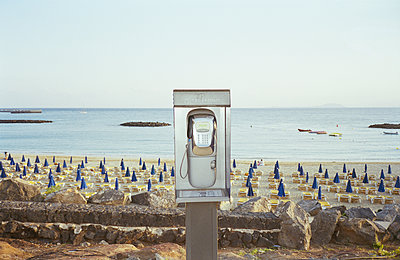Payphone by beach - p956m1136865 by Anna Quinn