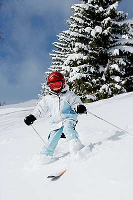 Young girl skiing - p4292875f by Adie Bush