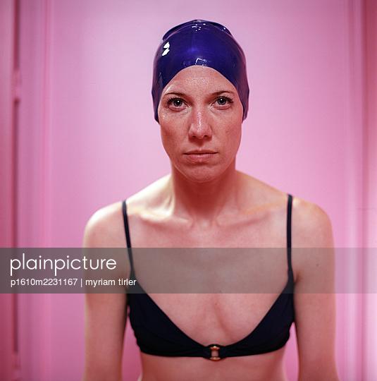 A woman wearing a blue bathing cap - p1610m2231167 by myriam tirler