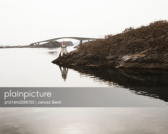 Lighthouse and bridge in the archipelago - p1214m2258723 by Janusz Beck