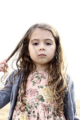 Portrait of little girl - p1019m2149527 by Stephen Carroll