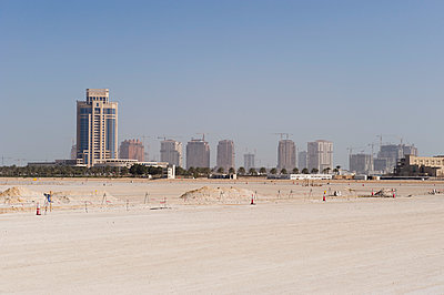 Scenic view of field and cityscape against sky - p301m1130802f by Paul Hudson