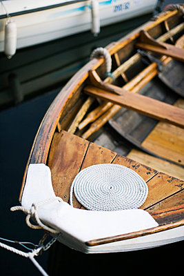 A coiled rope on a moored boat - p426m719611f by Kentaroo Tryman