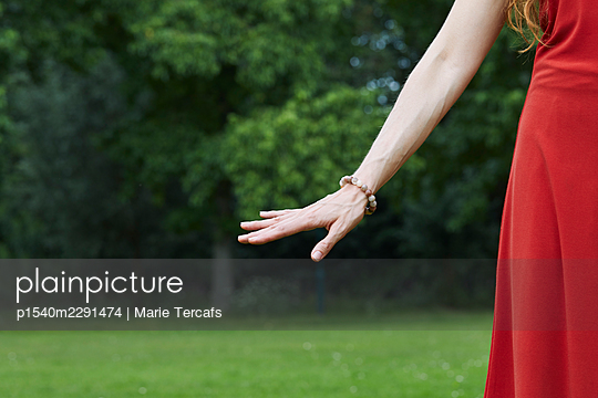 Hand of a female shaman in nature - p1540m2291474 by Marie Tercafs
