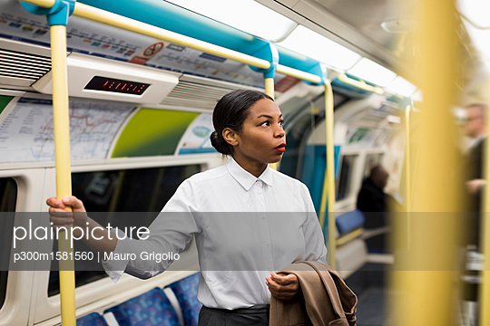 UK, London, portrait of businesswoman in underground train - p300m1581560 von Mauro Grigollo