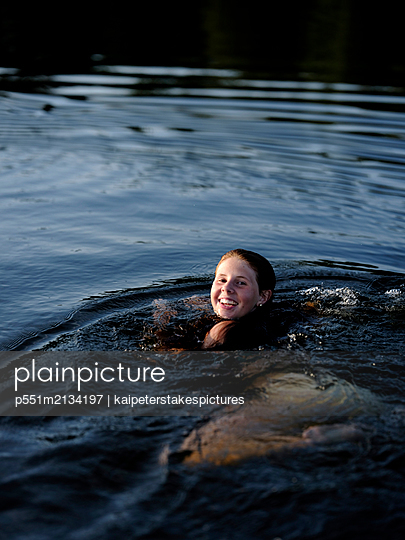 Swimming in the lake - p551m2134197 by kaipeterstakespictures