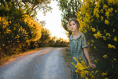 Girl in Yellow Flowers - p1503m2015854 by Deb Schwedhelm
