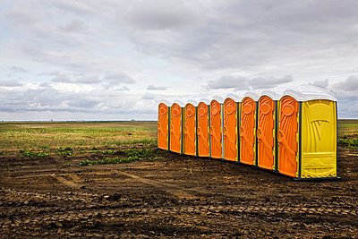 Row of portable toilets at a construction site - p8360053 by Benjamin Rondel