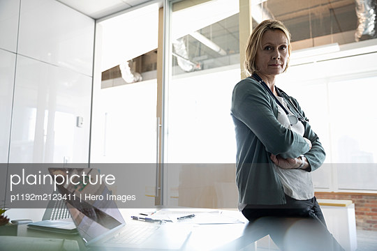Portrait of serious female medical consultant in office - p1192m2123411 by Hero Images