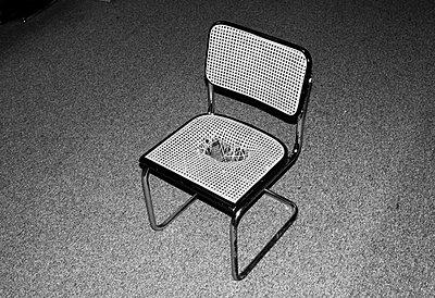 Hole in a chair - p1153m951522 by Michel Palourdiau