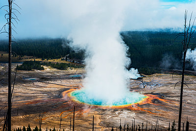 Majestic view of steam emitting from hot spring at Yellowstone National Park - p1166m1509459 by Cavan Images