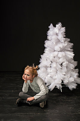 The girl and white Christmas tree in studio - p1412m1503424 by Svetlana Shemeleva