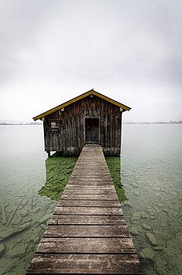 Germany, View of bathhouse at Lake Kochelsee - p300m752505f by Michael Bottari