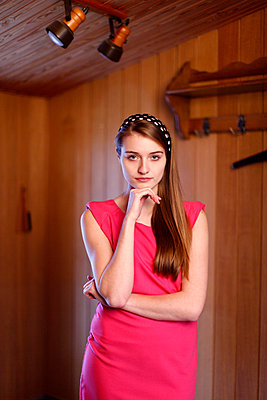 Young woman with pink dress - p249m1002931 by Ute Mans