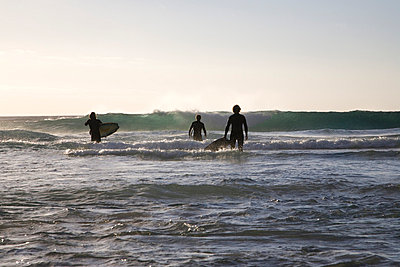 Three surfer waiting for the wave - p7620004 by Bodo Krug