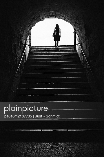 Woman on stairs - p1616m2187735 by Just - Schmidt