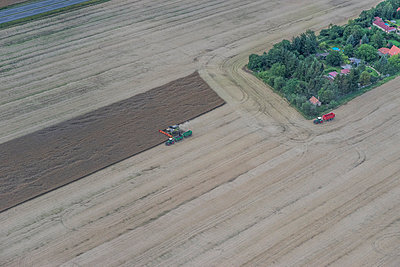 Germany, aerial view of combine harvester at work on a field - p300m1059217f by Patrice von Collani