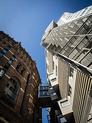Austria, Vienna, view to facades of gasometer and extension building from below - p300m975083f by Dieter Schewig