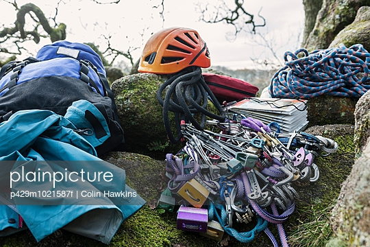 Climbing equipment and helmet on rocks - p429m1021587f by Colin Hawkins