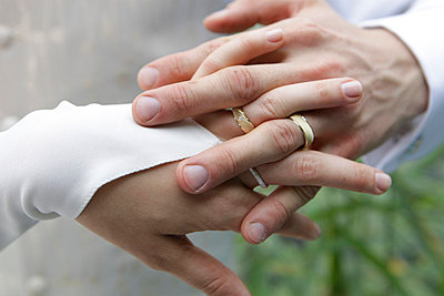 Hands of a bridal couple - p5020224 by Tomas Adel