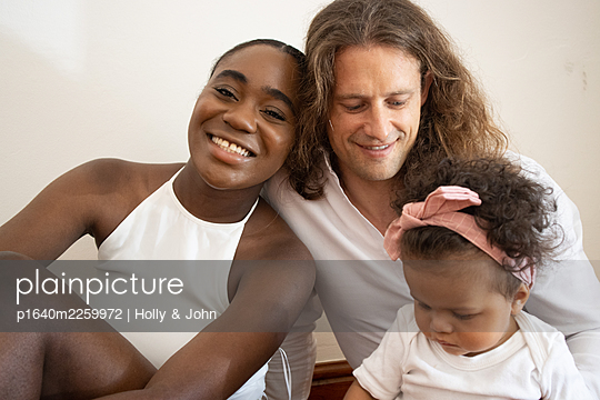 Multi ethnic family with toddler girl - p1640m2259972 by Holly & John