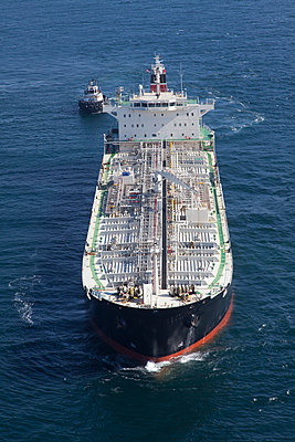 Oil tanker with tugboat at sea - p555m1420394 by Tom Paiva Photography