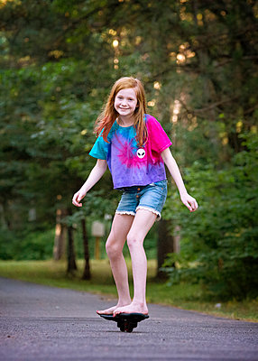 Pre Teen Red Haired Girl Ripsticking - p1166m2208070 by Cavan Images