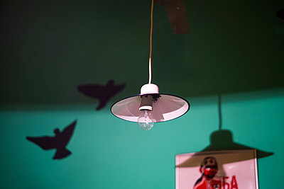White retro pendant lamp with green wall in the background  - p1527m2116784 by Slaveng