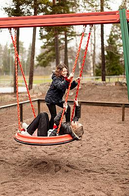 Girls on swing - p312m2190979 by Scandinav