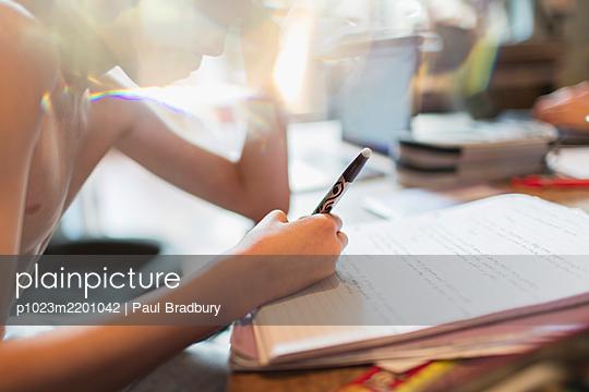Close up boy homeschooling - p1023m2201042 by Paul Bradbury