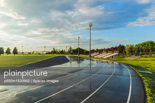 plainpicture | Photo library for authentic images - plainpicture p555m1532662 - Wet bleachers and running t... - plainpicture/Blend Images/Spaces Images