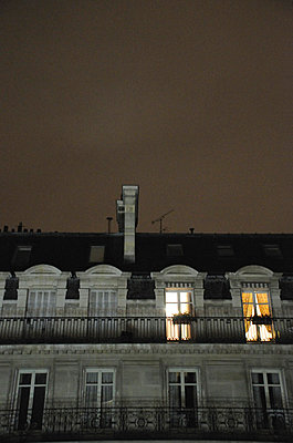 View of apartment block at night in Paris (II) - p1072m829271 by Neville Mountford-Hoare