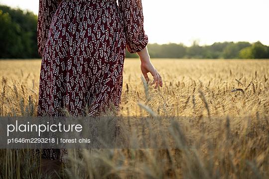 Woman in a cornfield - p1646m2293218 by Slava Chistyakov