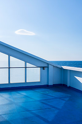 Deck of ship against blue sky - p280m1111716 by victor s. brigola