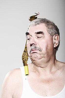 Man with dead flies fallen on his head - p4030995 by Helge Sauber