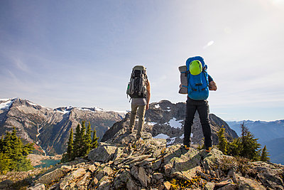 Two mountaineers look at their objective, Douglas Peak, B.C., Canada. - p1166m2095124 by Cavan Images