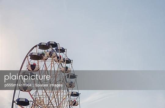 Ferris wheel against blue sky