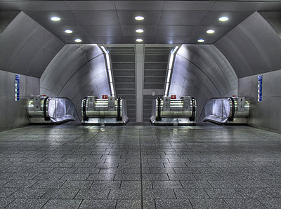 Empty escalators in Kings Cross underground station  - p1072m829329 by Neville Mountford-Hoare