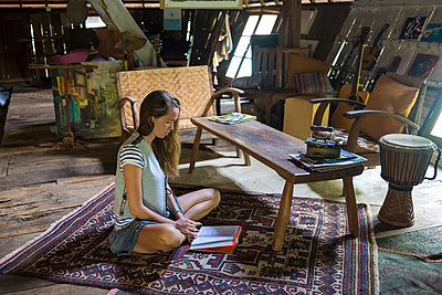 Young woman in Sulawesi wood house - p1108m1004222 by trubavin
