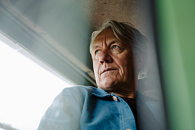 Portrait of a senior man on tractor - p300m2202704 by Gustafsson