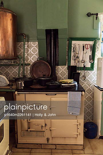 Old-fashioned kitchen with stove - p1640m2261141 by Holly & John