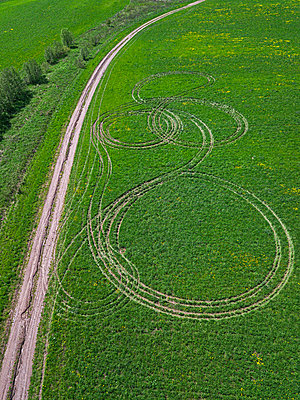 Green field, wheel tracks, drone photography - p1108m2193206 by trubavin
