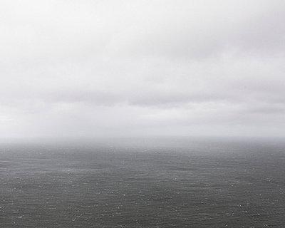 Sea in haze - p1214m2258727 by Janusz Beck