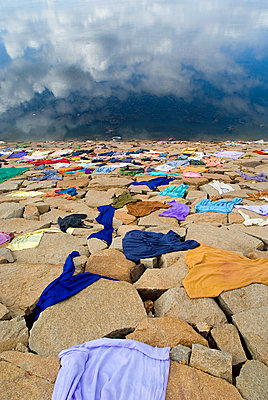 Washed Clothes Drying on Stones on Lake Edge - p1562m2263576 by chinch gryniewicz