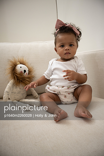 Multi ethnic toddler girl with cuddly toy - p1640m2260028 by Holly & John