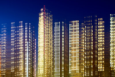 Illuminated office buildings - p464m2157780 by Elektrons 08