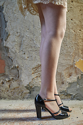 Woman's legs in an abandoned house - p1540m2141275 by Marie Tercafs
