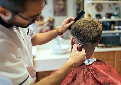Barber shaving head of a customer - p300m1081388f by Marco Govel